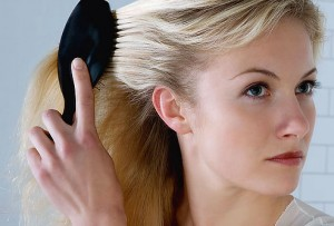 photolibrary_rf_photo_of_woman_brushing_hair1